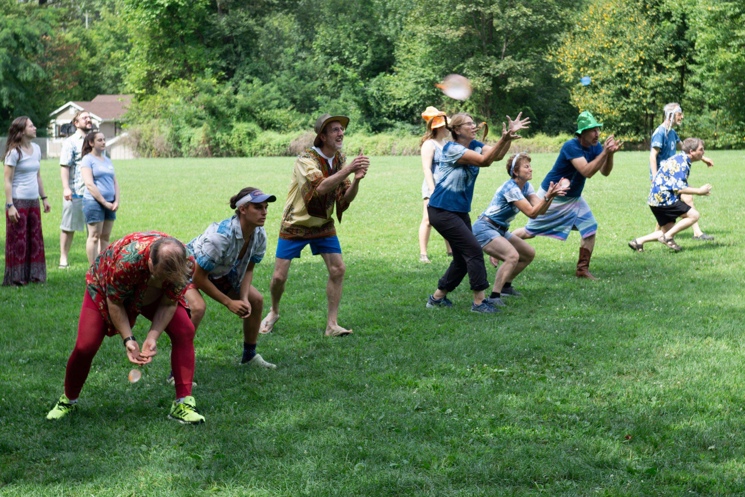 Campers play a game with water balloons